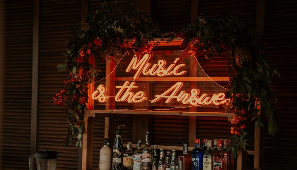 music is the answer neon writing behind bar
